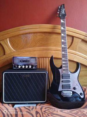 Guitarra ibanez con amplificador vox valvular