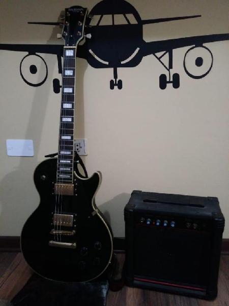 Guitarra eléctica modelo les paul y amplificador