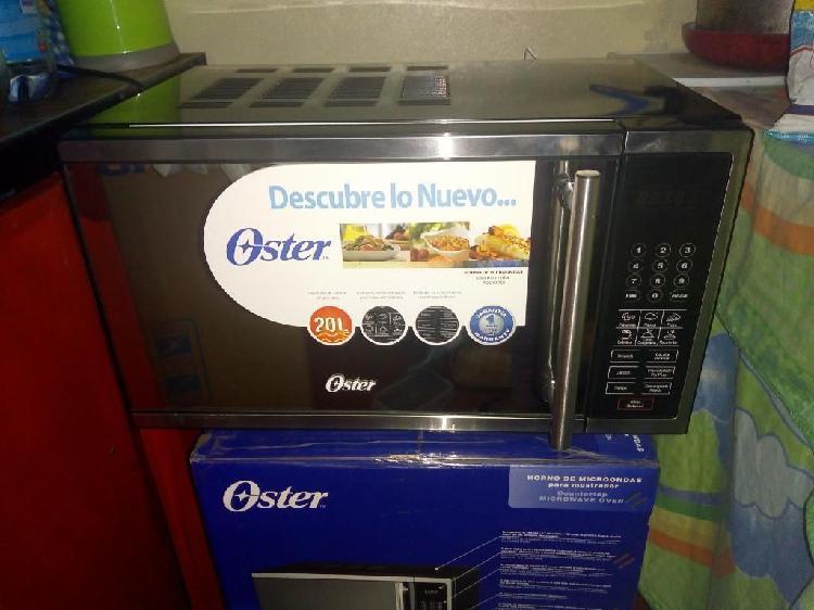 Se vende horno microondas oster nuevo.