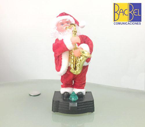 Papa noel musical y bailando, con luz decorativa