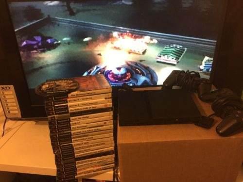 Playstation 2 con dos mandos mas juegos!