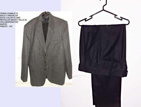 Vendo terno saco color plomo con 2 pantalones color negro y
