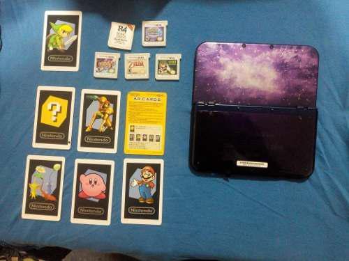 Nintendo 3ds xl con 4 juegos, cargador, 7 tarjetas virtual